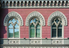 Three Windows with arches in old architectural building.  Royalty Free Stock Photography