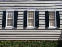Three Windows with Black Shutters Stock Photo
