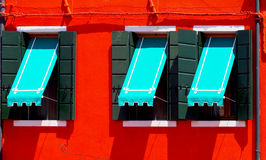 Three Windows with blue canopy Royalty Free Stock Image