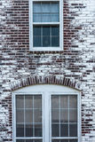 Three Windows in Brick Wall Royalty Free Stock Image