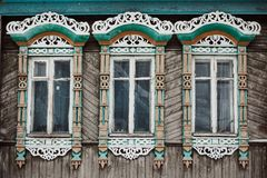 Three windows with decorative wood carving frame royalty free stock images