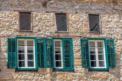 Three windows on facade of house Stock Photography