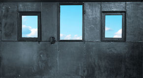 Three windows in the metal room Royalty Free Stock Image
