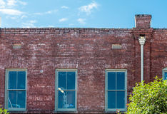 Three Windows in Old Brick Building Royalty Free Stock Photos