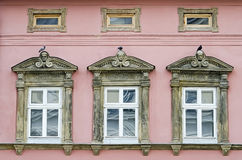Three windows in an old house Royalty Free Stock Photos