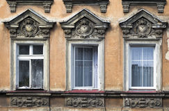 Three windows in an old house Royalty Free Stock Photo