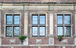 Three windows of old Raesfeld water castle in Germany Stock Image