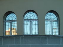 Three windows with reflection Stock Image