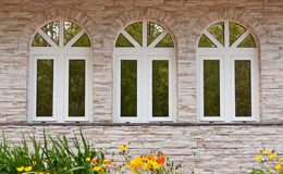 Three windows in the stone wall Stock Photography
