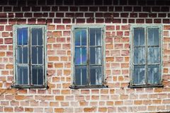 Three windows in a train yard. At chama stock photography