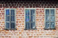 Three windows in a train yard Stock Photography
