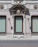 Three windows with unusual stucco Stock Images
