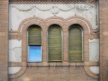Three windows on the wall Stock Photos