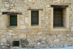 Three windows. On a wall of an old house in a village in Spain Royalty Free Stock Photography