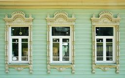 Three Windows With Wooden Platbands Royalty Free Stock Photography
