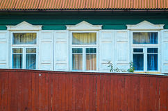 Three Windows on wooden facade Royalty Free Stock Photo