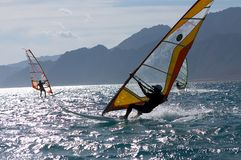 Three windsurfers stock photos