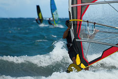 Three windsurfers in action Stock Image
