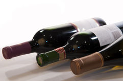 Three Wine Bottle Horizontal. Closeup of three wine bottles at an oblique angle Royalty Free Stock Photo
