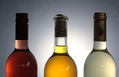 Three wine bottles with backlight Royalty Free Stock Images