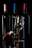 Three wine bottles and corkscrew Stock Photography