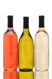Three Wine Bottles over a White Background. A group of three different wine bottles with reflection over a white background. White Zinfandel, Chardonnay and Stock Photography