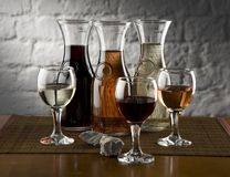 Three wine brands. In glasses and jugs Royalty Free Stock Photo