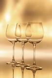Holiday celebration - wine glasses. Three wine glass with multiple back lights Stock Images