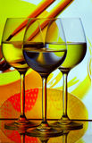 Three wine glasses. Arranged against cookware background Royalty Free Stock Photography