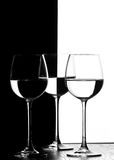 Three wine glasses. In backlight on the black and white contrast background Stock Photos