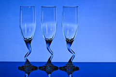 Three wine glasses with blue background Royalty Free Stock Images