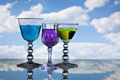 Three wine glasses in front of sky royalty free stock photography