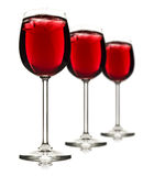 Three wine glasses with red fruit juice and ice Royalty Free Stock Images