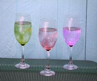 Three wine glsses on a table royalty free stock photography