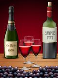 Three wineglass and champagne bottles Stock Images