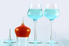 Three wineglasses with blue and orange water Stock Photo