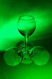 Three wineglasses on a green background Royalty Free Stock Photos
