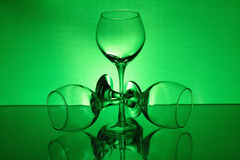 Three wineglasses with a green light Stock Photography