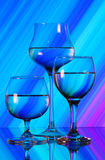 Three wineglasses on the mirror Stock Images