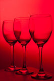 Three wineglasses on red background Stock Images