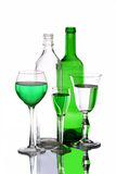 Three wineglasses and two bottles on the mirror Royalty Free Stock Photography