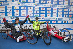 The three winners of the race handbike. Royalty Free Stock Images