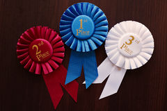 Three winners rosettes Royalty Free Stock Photos