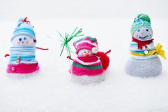 Three winter snowman Stock Images