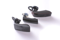 Three wireless bluetooth headsets - headphones Royalty Free Stock Images