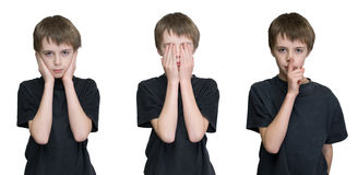Three wise boys. A young male child depicting the three wise monkeys old saying hear, see and speak no evil royalty free stock images