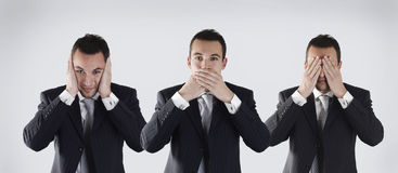 Three wise businessman. That they didn't hear, speak and see Stock Photo