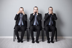 Three wise businessman Stock Images