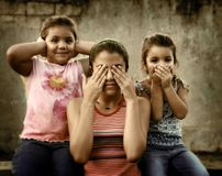 Three wise girls. Three girls making the See no evil, hear no evil, speak no evil proverbial Stock Photography