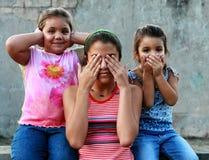 Three wise girls II. Three girls making the See no evil, hear no evil, speak no evil proverbial Stock Photo